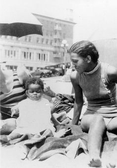 Verna Williams with the child of a friend at Ink Well in 1931.When Santa Monica Beach was segregated (Photo courtesy of Los Angeles Public Library Photo Collection)