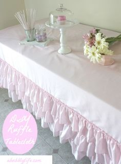 Pretty. So easy DIY ruffle tablecloth.  This would be so great as a wedding idea.