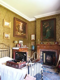 Captain Tommy's Bedroom -Lanhydrock House - Bodmin - Cornwall - England.  Tommy's valise open on the bed; it came home from the war, he didn't.  Still exactly as it was when his parents got it.  Still has rouge in it, so that his troops wouldn't know he was so scared.