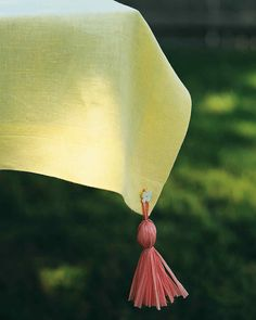 Tablecloth Weights Come your next backyard dinner, these tassels will keep the wind from blowing your tablecloth into the neighbor's pool. Make Tablecloth Weights Tablecloth Weights, Outdoor Tablecloth, Graduation Celebration, Graduation Ideas, Graduation Tassel, Graduation 2015, Graduation Decorations, Martha Stewart Crafts, Outdoor Parties