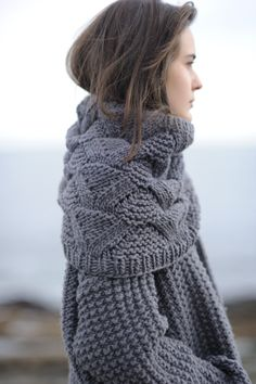 grey wooly things. like the cowl and the jumper