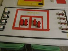 Matching numbered firetrucks with fire stations.   Teaching preschool.org