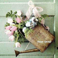 Another cute spring door idea!  I found this last year and wanted to do this project but couldn't find the watering can