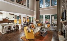You want your large open-concept living room to inject some personality into the spaces beyond. The yellow accent chair accomplishes that here.