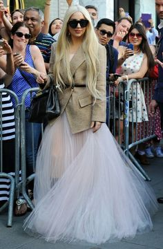 Lady Gaga goes for a 'pretty in pink' look as she meets fans in New York.   Read more: http://www.1047kissfm.com/photos/icons/pop-pics-948/22627384/#/13/22625959#ixzz333KO915x