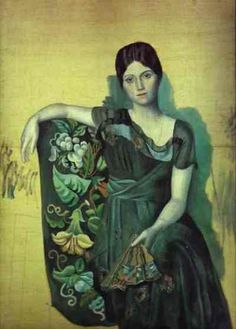 """""""Portrait of Olga in the Armchair"""", 1917, by Pablo Picasso (Spanish, 1881-1973). In 1917, ballerina Olga Khokhlova (1891-1955) met Picasso while the artist was designing """"Parade"""" for the Ballet Russe in Rome. They married in the Russian Orthodox church in Paris in 1918 and lived a life of conflict. She was of high society and enjoyed formal events while Picasso was more bohemian. Their son Paulo (Paul) was born in 1921, influencing Picasso's imagery to turn to mother and child themes."""