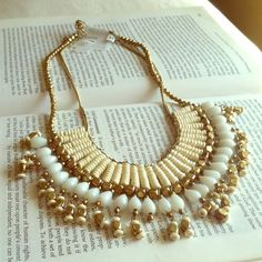 Cleopatra Necklace  Brand new with tags - made of gold plated material - not real gold - has beige beads with gold strands - very popular piece - will stand out with any outfit - missing one little bead not to noticeable - Jewelry Necklaces