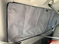 Our Ford Econoline Van Deluxe Insulated Magnetic Passenger Side Rear Window Cover help keep the inside temperature constant by keeping heat (or cold) from escaping or entering through the windows. The magnetic window cover provides privacy and blocks the light for stealth camping any time of day.