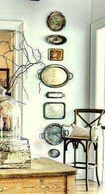 Display of old silver trays on wall...never mind the tarnish