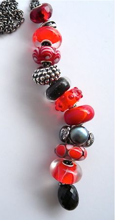 Fantasy Necklace with all our favorite new coral reds... by Trollbeads