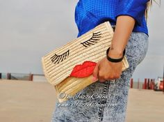 """The """"Pucker Up"""" Handbag can be worn as a clutch or over the shoulder bag. It comes with a black and silver chain strap. www.jazzychica.com"""