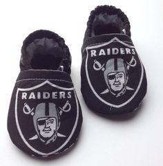 Super cute cloth baby shoes for the avid sports family. They have an elastic band in the heel to keep them on your little ones feet. This is a very easy