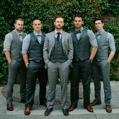 I like the idea of coordinating but not matching everyone. Groom with long tie and groomsmen with bowties, etc... Monochromatic Groomsmen Wedding outfit idea.