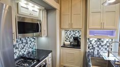 Beachfront Luxe 45FB Toy Hauler decor Luxury Fifth Wheel, Fifth Wheel Toy Haulers, Kitchen Cabinets, Kitchen Appliances, Build Your Own, Toys, Building, Home Decor, Diy Kitchen Appliances