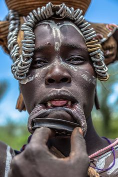 Mursi tribe woman with the cut lip-mago national park-omo valley-ethiopia by anthony pappone photographer, via Flickr