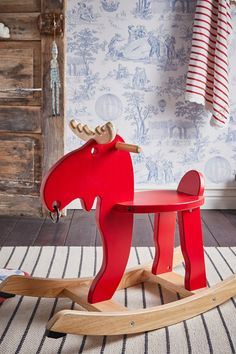 IKEA - EKORRE, Rocking moose, red, rubberwood, Rocking helps develop a child's sense of balance and the brain to sort sensory impressions. Recommended for children 18 months and older. This product bears the CE mark.