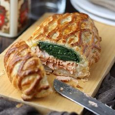 Baked salmon en croute.Fresh salmon fillets with spinach and famous Bechamel sauce cooked in the oven.