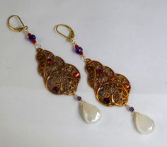 Beautiful French brass stampings, with 'Volcano' Swarovskis and pearlized white Chalcedony stones by ChrisAllenJewelry on Etsy  $42 CAD