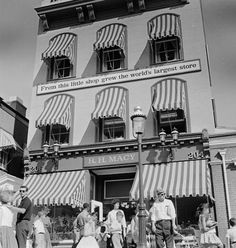 """Striped awnings cover the windows of R H Macy, a historical shop in Freedomland Park, a Wild West themed park in the Bronx, New York City. ..."