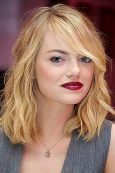Emma Stone~ Loosely pull back the front pieces of a shoulder-length style for a casual daytime 'do.