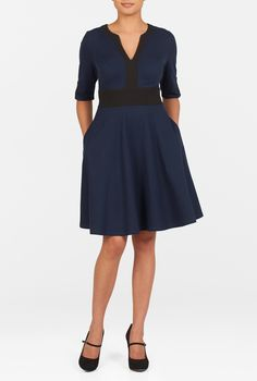 A flared skirt below the contrast banded waist highlights the feminine figure in our smart colorblock dress cut from stretchy cotton knit.<li>Slips on over head; partial side hidden zip closure.<li>Contrast banded split neck. <li>Elbow-length sleeves with contrast trim at the split cuffs. <li>Princess seamed bodice.<li>Side seam pockets. <li>Above knee length. <li>Cotton/spandex, jersey knit, light stretch, light structured feel, midweight. <li>Machine wash cold.