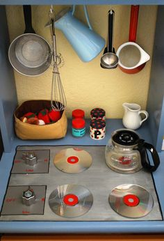 Make your own play kitchen from an old desk. The CDs for stove burners are so awesome!
