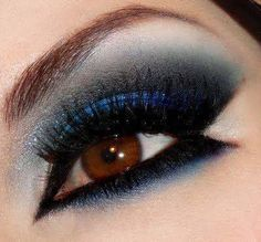 Awesome blue shadow and black eyeliner/ shadow.