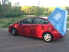 """""""easy-to-store tent retails for less than $ 100 and folds up into a small sac that can fit into the glove compartment of the vehicle. It attaches to the rear of the hatchback and turns the usually cramped rear of the car into a fairly spacious sleeping arrangement. """" Prius Habitents Photos 1 - Tiny Vehicle Tents pictures, photos, images"""