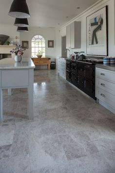 Our beautiful and extremely versatile Tundra Tumbled Marble looks fantastic in this stunning kitchen | Mandarin Stone