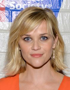 Reese Witherspoon Medium Wavy Cut with Bangs - Reese Witherspoon sported subtle waves with side-swept bangs when she attended the Hollywood Stands Up to Cancer event.
