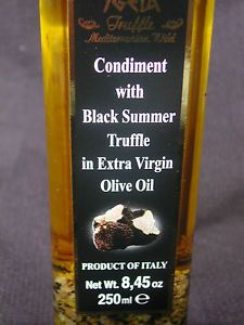 "BLACK SUMMER TRUFFLE IN EXTRA VIRGIN OLIVE OIL, 250ml with ""10%"" black truffle.   10% real truffle & not just truffle flavored oil like most."