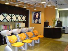 Great salon idea. Love how the backbar and towel area is set up. Personally not a fan of the color yellow.