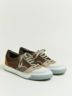 Lanvin Men's Multi Panel Low Top Sneakers from AW 12 collection in camel.        Crafted from calfskin leather in variety of brown colours and textures.      Fastens with brown lace through six silver metal eyelets.      Insole is in dark brown with the words 'Lanvin' embossed.      White rubber composite sole with a grey ripple under sole.      100% calfskin leather.