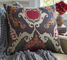 Mercer Ikat Applique Pillow Cover #potterybarn A pillow like this makes a bland chair fit in the BoHo look.