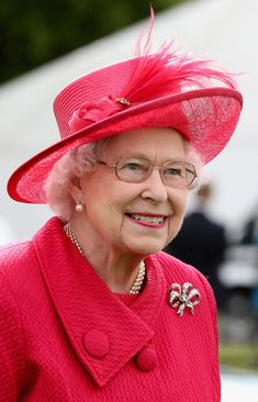 Queen Elizabeth II arrives at the Cartier Queen's Cup Final at Guards Polo Club on 16 June 2013 in Egham, England