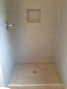 large subway tile shower with niche