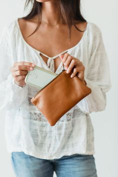 When you just want to take your phone, credit card, cash or keys out, the KARMME mini is the perfect size. Pop her into your larger KARMME clutch or take her out by herself.  Minis are approximately 12cm x 20 cm in size Fits iphone 7 or equivalent.