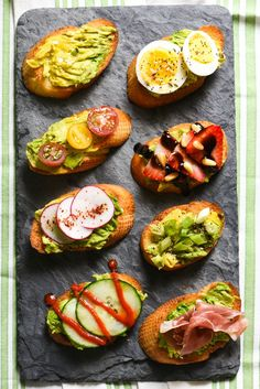 Grilled Avocado Crostini Board - A fun party idea! Pile a bunch of fresh toppings onto a big platter, and let your guests assemble their own grilled avocado crostini!   http://foxeslovelemons.com