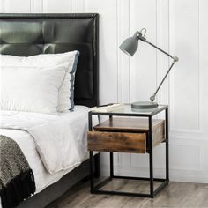 Get inspired with these modern bedside table ideas. This list showcases stylish bedside tables for modern, classic, rustic, and industrial bedrooms - and many bedroom furniture themes in between. Rustic Wooden Shelves, Rustic Cabinets, Wood Shelf, Modern Bedside Table, Black Bedside Tables, Bedside Table Styling, Bedside Table Decor, Metal Nightstand, Nightstands