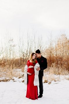 e31e0cf33d3db Beautiful mama-to-be in a long red dress at sunset for dreamy golden hour maternity  photos in the snow with her husband. Maternity Photography Poses In ...