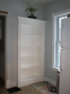 Hidden Door to basement. I so want this...would make a great kitchen shelf and get rid of an ugly door, too.