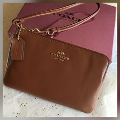 """Coach Wristlet. Beautiful Tan Coach Wristlet with Gold signature Coach on the front.  Corner zip strap, two slip pockets on the inside.  Great size, 7"""" X 4"""". Will fit the iPhone 6s. NWT. Coach Bags Clutches & Wristlets"""