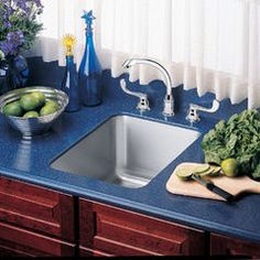 Kitchen sinks by Elkay sinks +faucets like the blue counter around sink makes it look more classy.