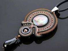 Beautiful, impressive soutache necklace made of soutache strings with Mother of pearl, Hematite and glass beads. Full length: 3.2 inches. Length of string: 28 inches Colour: gray, graphite, gold and light pink.