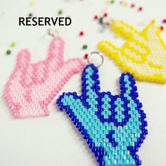 American Sign Language (ASL) beaded charm with the I Love You hand shape. Use it as a necklace pendant, bracelet charm or as a stylish
