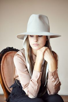 """I'm beyond smitten with Clyde designer Dani Griffiths' latest collection of hats. Honestly, how chic are the felted wool hats with their exaggerated crowns, pinched tops and removable neck wraps to keep them in place during unforeseen weather!? I'm needing the ivory version to feed my white"" // big hats"