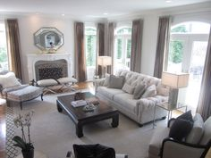 Design I did for a client..Updated Traditional. All products are from Ethan Allen. Chadwick sofa, Palma chairs, versailles Chair and Ottoman, zanadu stools, dynasty coffee table, crystal blocks floor lamp, oblong shell table lamps, zachary end tables, custom pillows and drapes, border rug