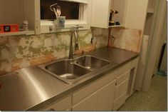 Couple created plywood countertop pattern and then took to a local sheet metal shop. By installing themselves (and doing all the measurements) the sheet metal shop charge them appx 20 dollars/square foot for the material and fitting. $400 total. [home depot quote  was 3 thousand]