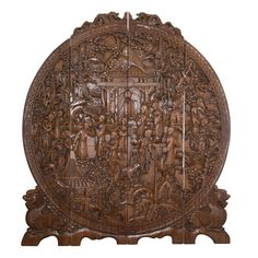 """Chinese Hand Carved Wooden Screen features deep carvings of chinese figures and villages. CIRCA: Early to mid 20th Ct. ORIGIN: China DIMENSIONS: L: 64"""" H: 73"""""""