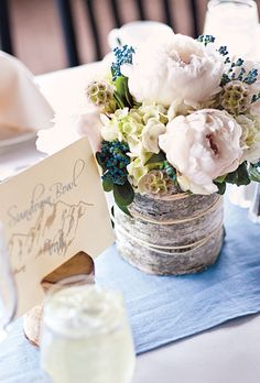 Brides.com: A Laid-Back Wedding in Breckenridge, CO. The tables, named after the couple's favorite ski runs, featured arrangements of peonies, berries, hydrangeas, and scabiosas in birch-wrapped vases. All flowers were by Bloom.